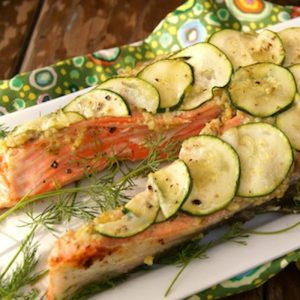 King salmon steak with sliced zucchini on top