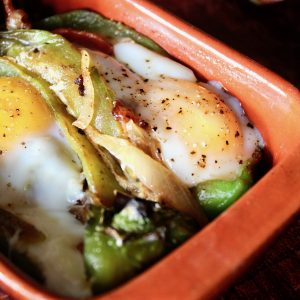 two Roasted stuffed Hatch Chiles with Bacon and Eggs