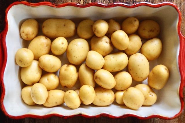 raw Baby Dutch Yellow Potatoes in baking dish