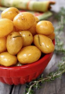 Baby Confit Potatoes in a red bowl
