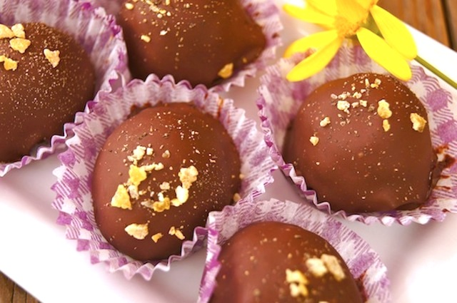 Close up of Lemon Pepper Chocolate Truffles with yellow flower