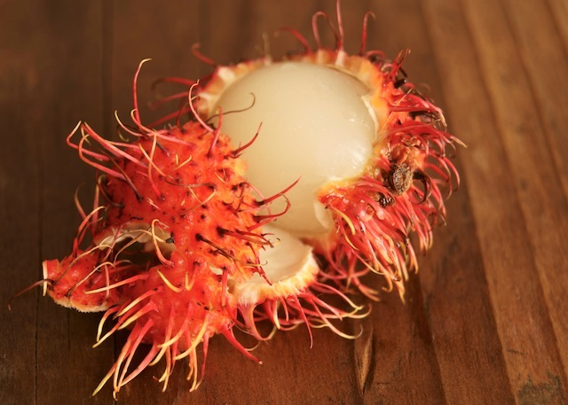One partially peeled Rambutan.