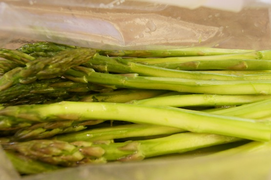 peeled asparagus on wax paper