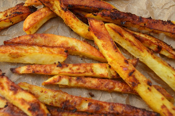 Curry French Fries spread out on parchment paper
