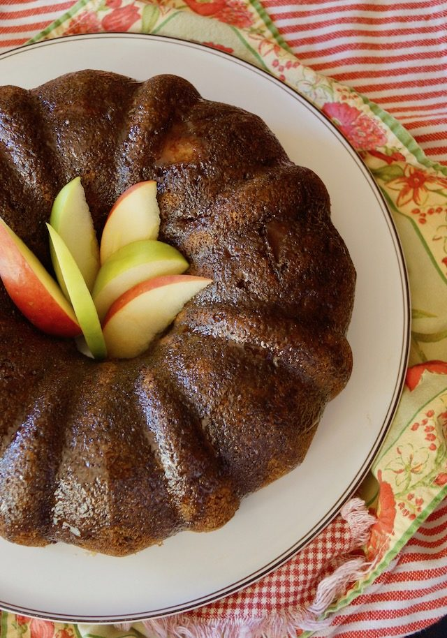 Top view of Chai Apple BundtCake with apple slices in the middle on red and green cloths
