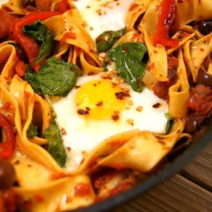 Sardinian Pasta in cast iron skillet with r fried eggs.