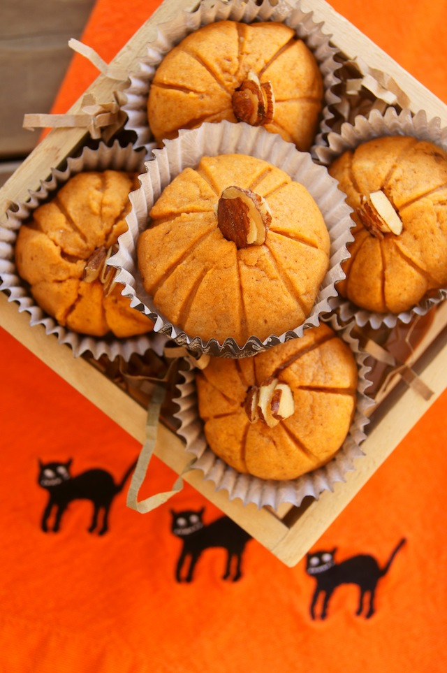 Pumpkin Almond Cookies for Halloween and Thanksgiving in a square wooden box on an orange napkin with 3 black cats on it.