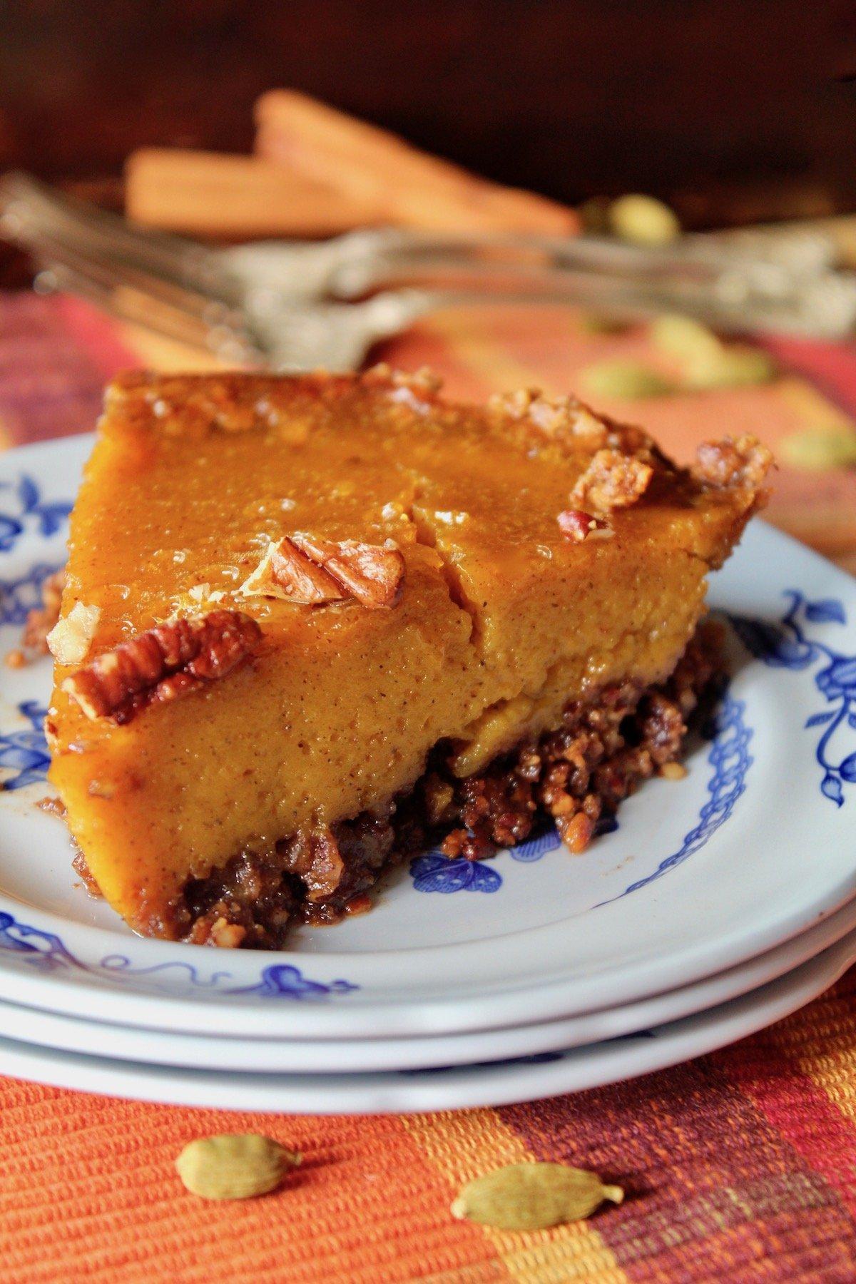 close up of a slice of pumpkin pie