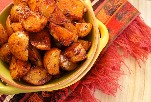 Roasted Ancho Chile Potatoes in a light green bow.