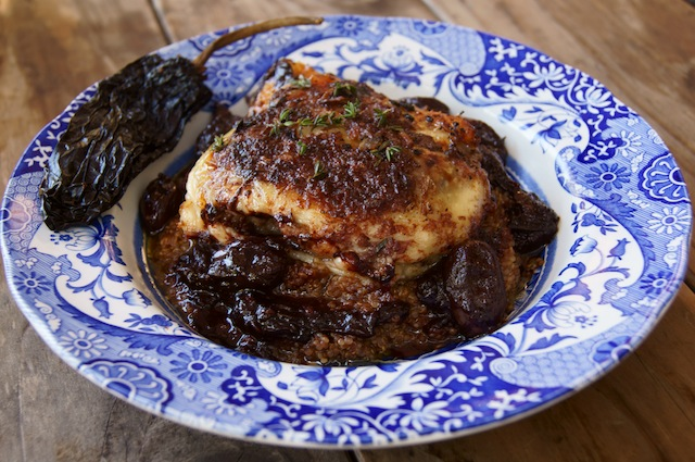Ancho Chile-Red Wine and Grape Roasted Chicken and Quinoa on an antique blue and white bowl.