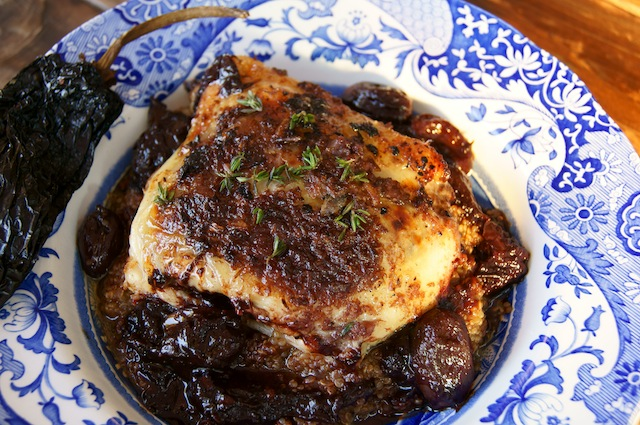 Ancho Chile-Red Wine and Grape Roasted Chicken and Quinoa in a Spode, blue and white bowl with a dried Ancho chile on the edge.