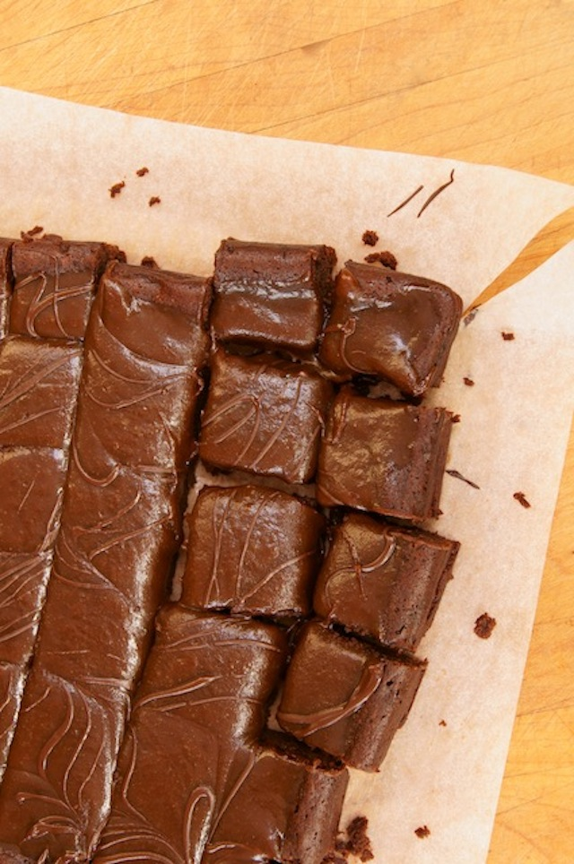 Gluten-Free Caramel Brownies with Espresso cut into squares on parchment.