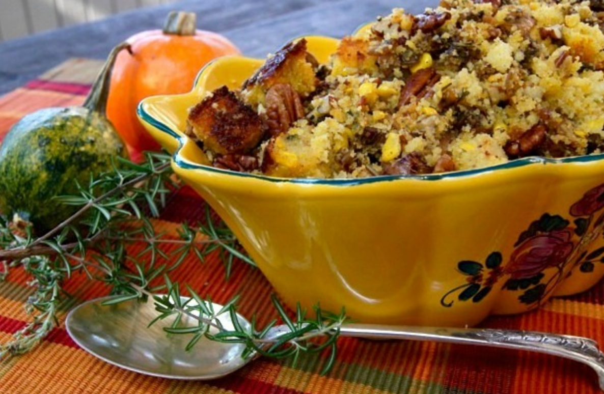 cornbread stuffing in yellow ceramic bowl