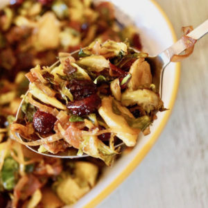Spoonfull of Shaved brussels Sprouts with prosciutto