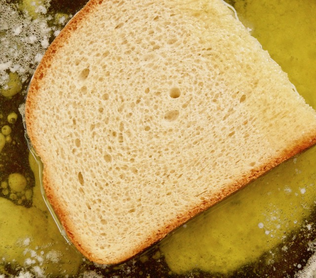 one slice of bread in melted butter