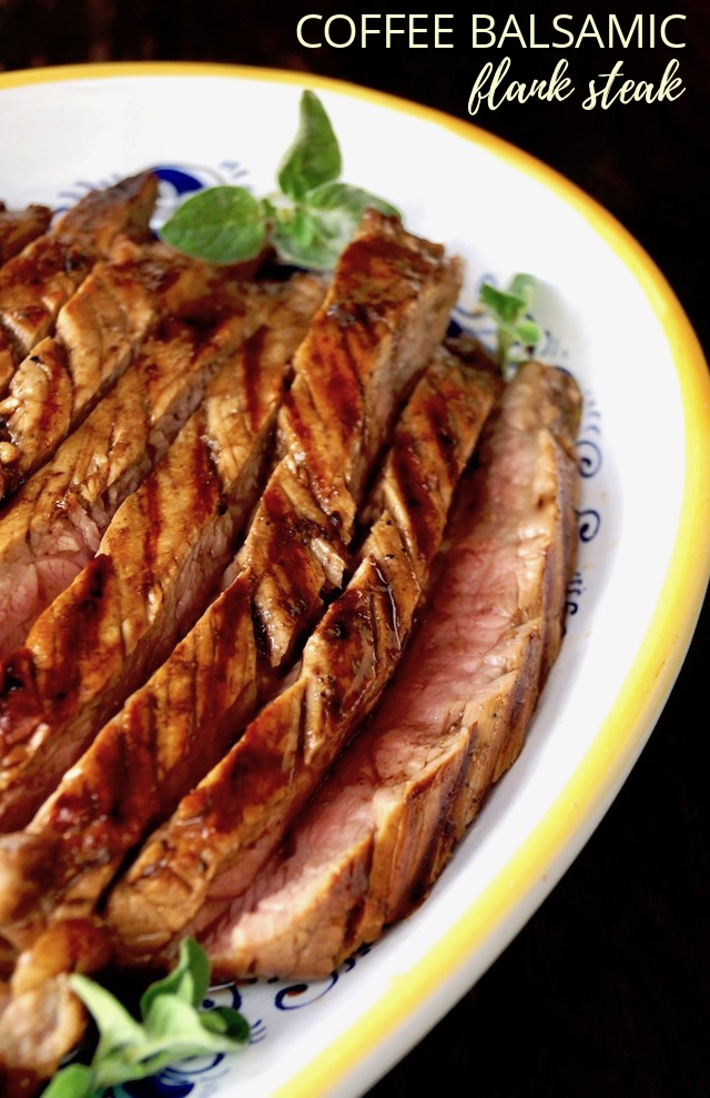 Large yellow-rimmed white platter filled with slices or grilled coffee balsamic flank steak.