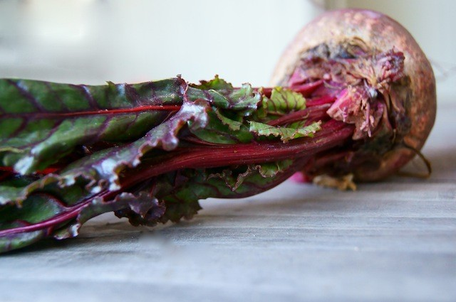 one raw beet on wood table