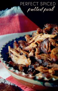 Perfect Spiced Pulled Pork, in pieces in a teracotta bowl.