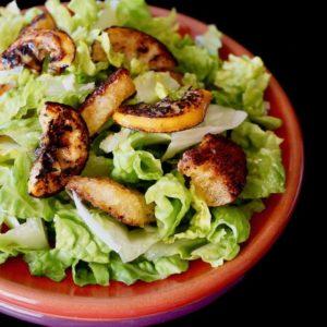 Fried Lemon Caesar Salad on a red plate.