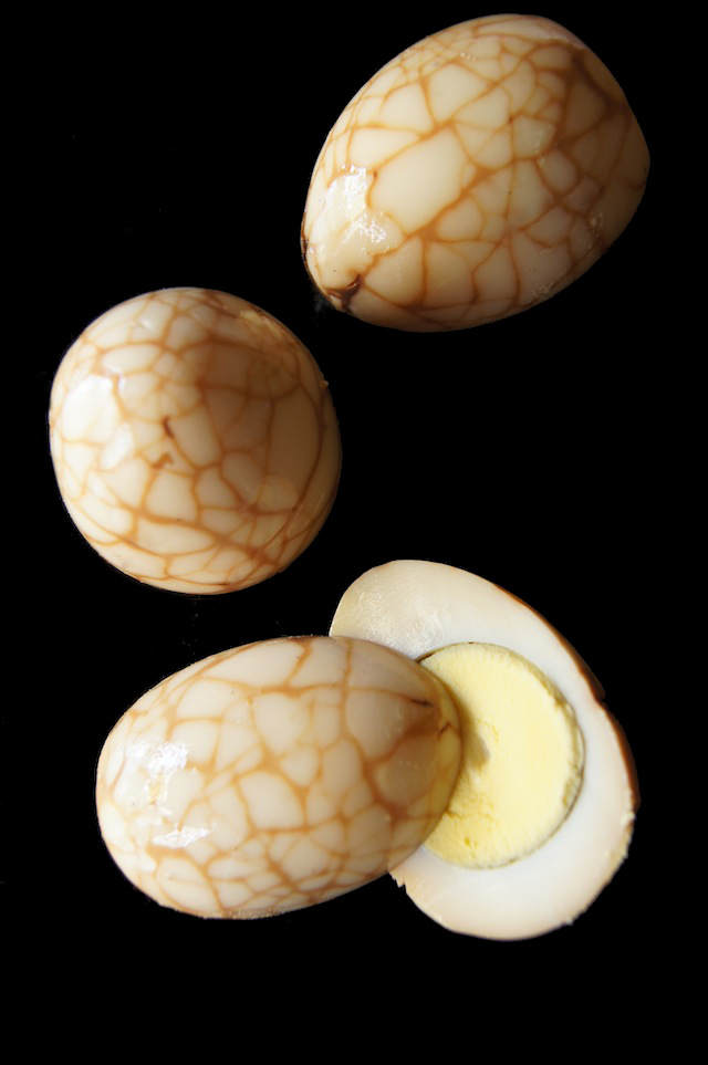 Chinese Marbled Tea Eggs on a black background