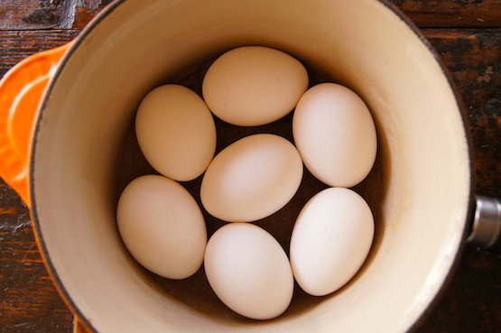 7 whole eggs in a pot