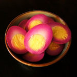 beet pickled eggs sliced in half
