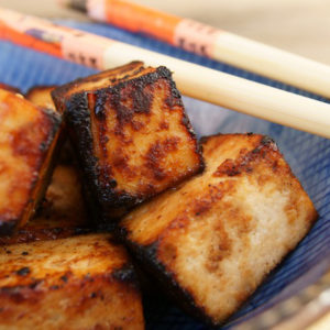 Miso Garlic and Ginger Tofu squares in a blue bowl