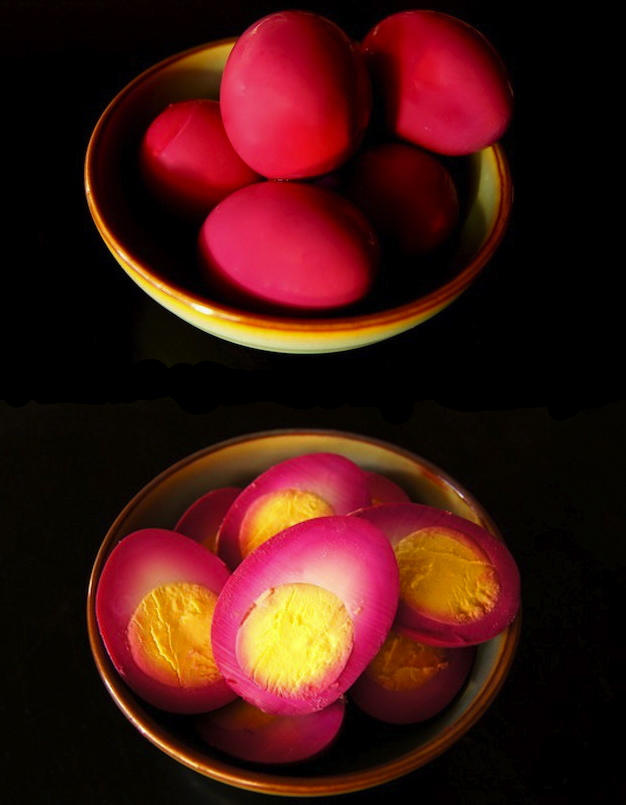 Top view of whole and sliced beet pickled eggs