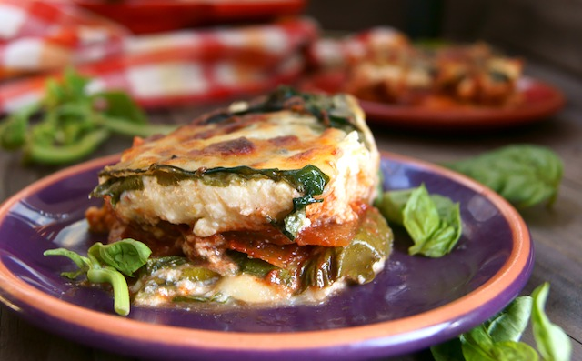 One slice of gluten-free, vegetarian Swiss Chard Lasagna on a purple plate.