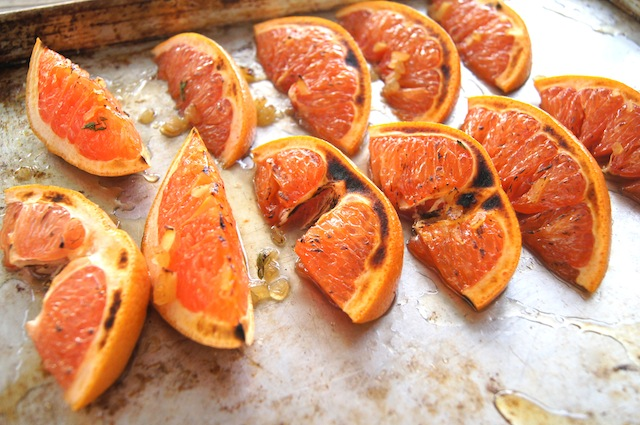 Broiled Grapefruit slices on a baking sheet