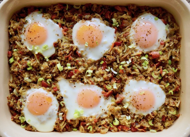 Bacon Hash Brown Casserole with six fried eggs on top