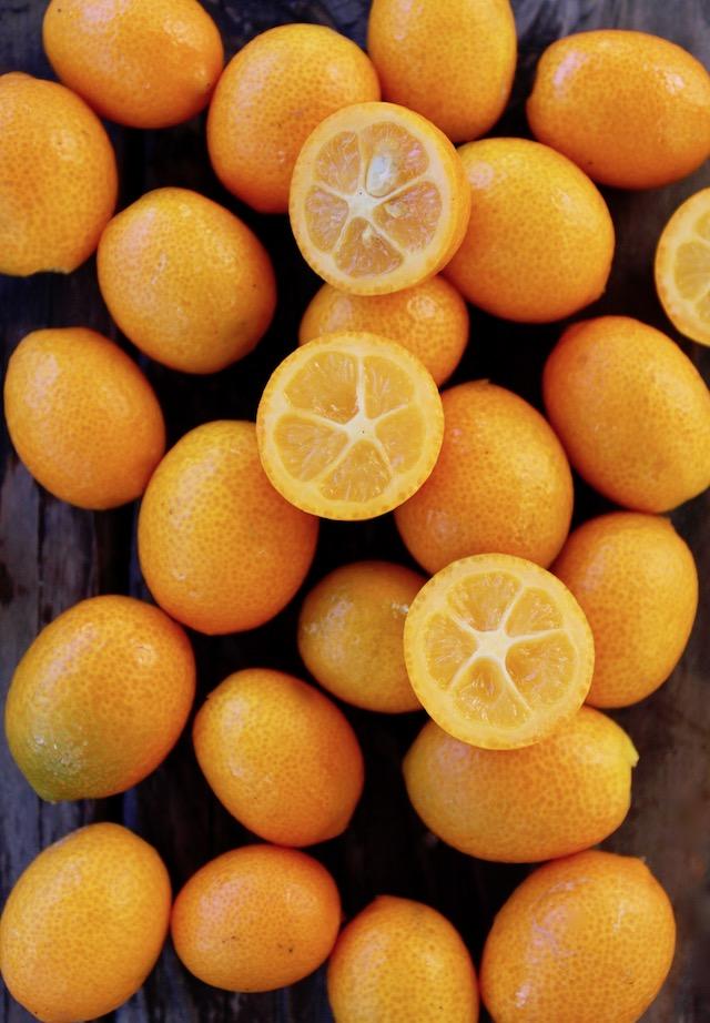 kumquats on wood surface