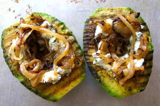 two grilled avocado halves with blue cheese and bacon and onion compote