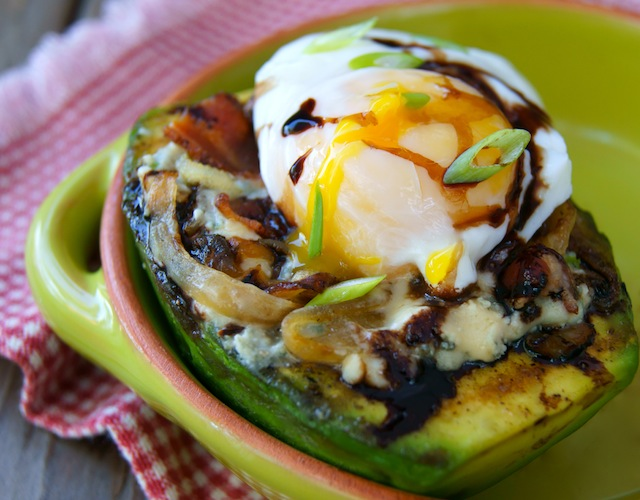 Grilled Avocado and Egg with Bacon Compote in a green bowl