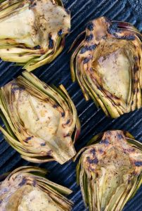 halved artichokes grilled on the grill