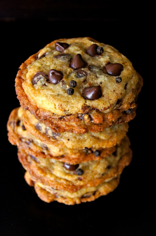 Stack of Kampot Black Pepper Chocolate Chip Cookies with a black background.