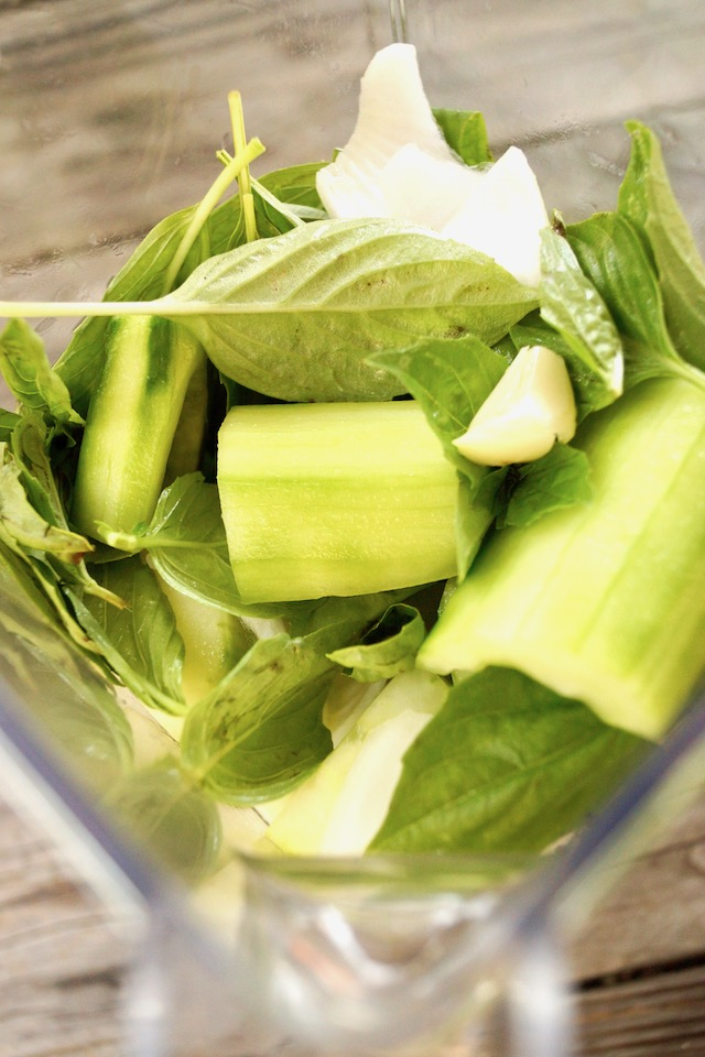 cut cucumber, garlic and basil leaves in blender