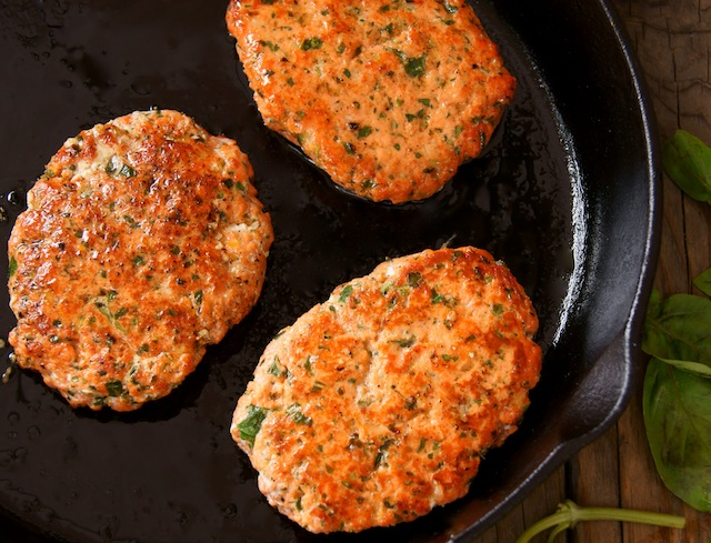 Spicy Sriracha Salmon-Basil Burgers in a cast iron skillet