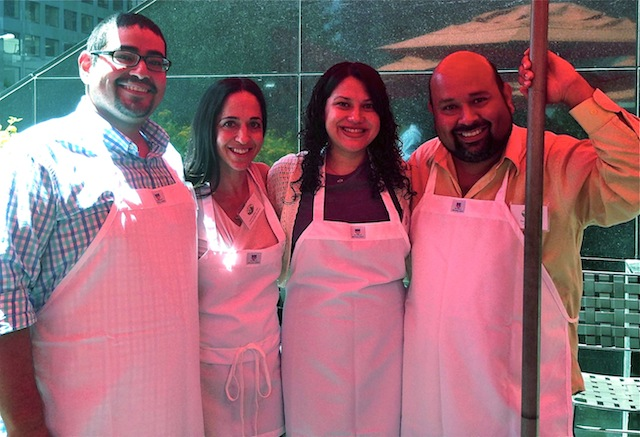 Photo of Valentina with 3 other food bloggers, all in white aprons.