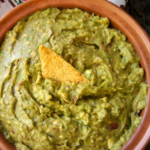 Smoky Lemon Chipotle Guacamole Recipe in a large teracotta bowl