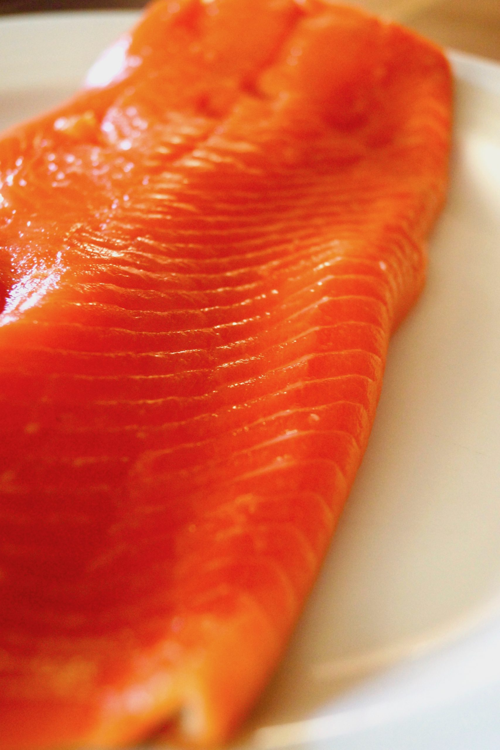 large, raw sockeye salmon fillet on cutting board