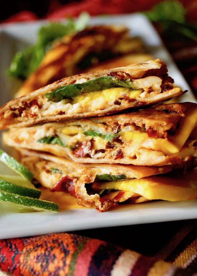 Stacked slices of Chipotle Mango Quesadillas