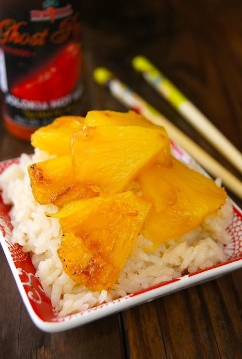 Coconut Sticky Rice with Spicy Pineapple in red bowl with chopsticks