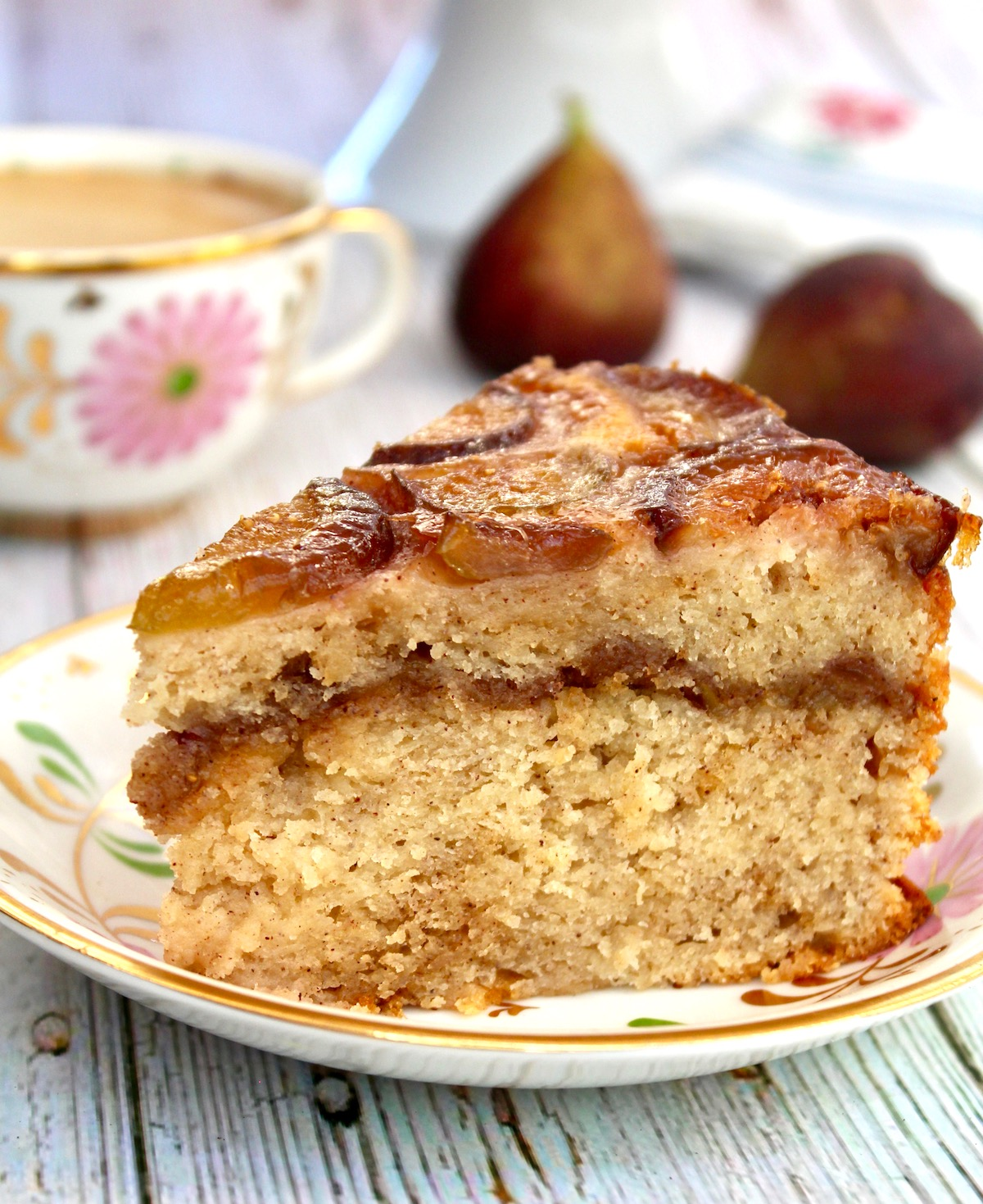 large slice of fig coffee cake on small floral plate
