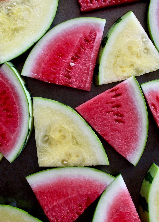 slices or yellow and red watermelon on baking sheet