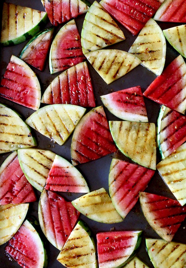 grilled watermelon slices on baking sheet