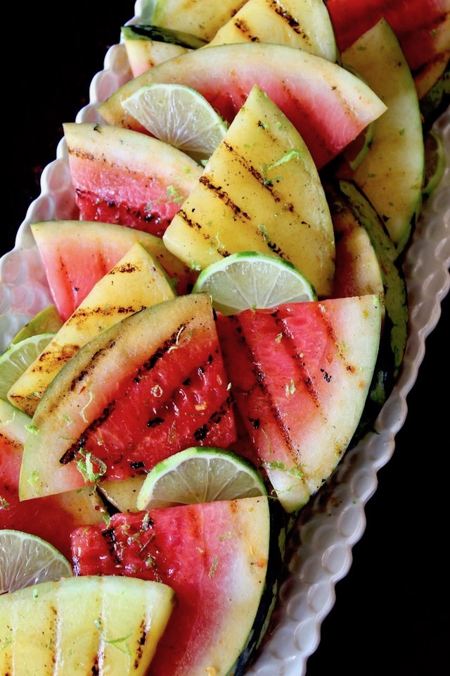 long white platter with red and yellow sliced, grilled watermelon
