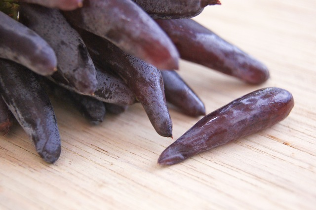 Witch Fingers Grapes bundle with one laying next to it.