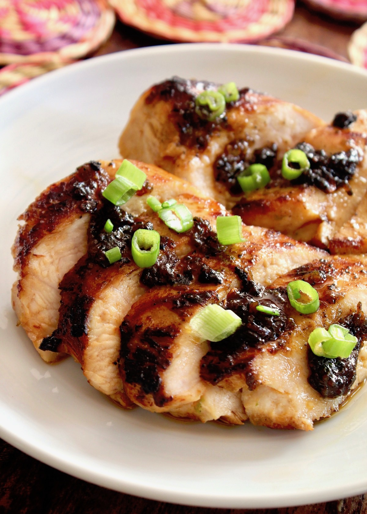 Sliced tequila chicken on a white plate