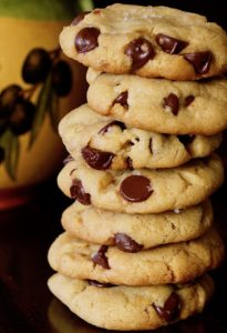 close up of tall stack of olive oil chocolate chip cookies